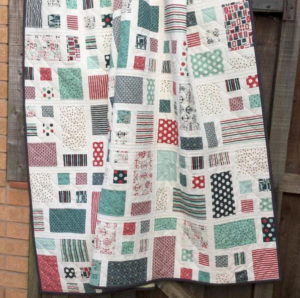 Disearing Nine Patch Quilt With Layer Cakes